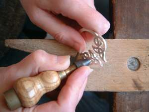 Polishing inside of the Celtic jewellery with a pin